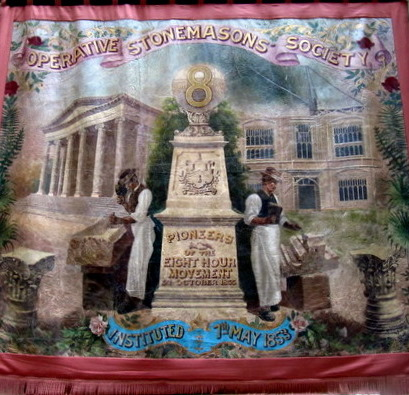Stonemason's Banner Celebrating the 8 Hour Day Victory (depicting the AGNSW, left, and the Sydney Uni edifice, right), courtesy Sydney Trades Hall.
