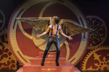 Man in leather trousers and mechanical wings.