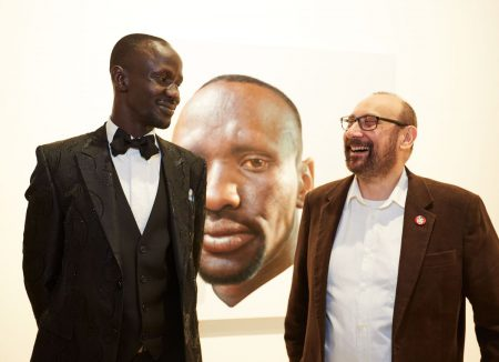 Artist Nick Stathopoulos with Deng Adut, the subject of his People's Choice winning portrait, Archibald Prize 2016
