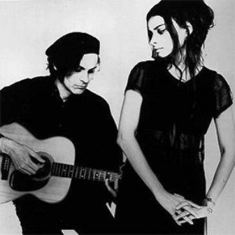 Black and white image of Mazzy star with a guitar