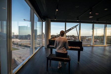 The music room with a grand piano at Green Square Library!