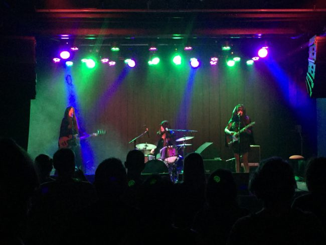 The 3 members of Bitch Diesel the band perform on stage